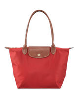 $50 off $200 reg-price Longchamp purchase @ Neiman Marcus